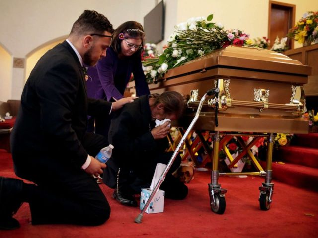 PHOTO: Antonio Basco is comforted during the wake of his wife Margie Reckard, murdered during a shooting at a Walmart store, in El Paso, Texas, U.S. August 17, 2019.