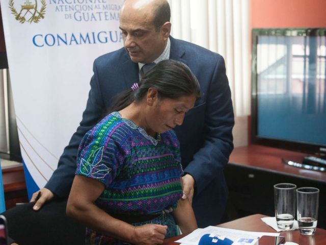 PHOTO: Dominga Vicente, front, is comforted by the National Migrants Commissioner Carlos Nares during a press conference in Guatemala City, May 25, 2018.