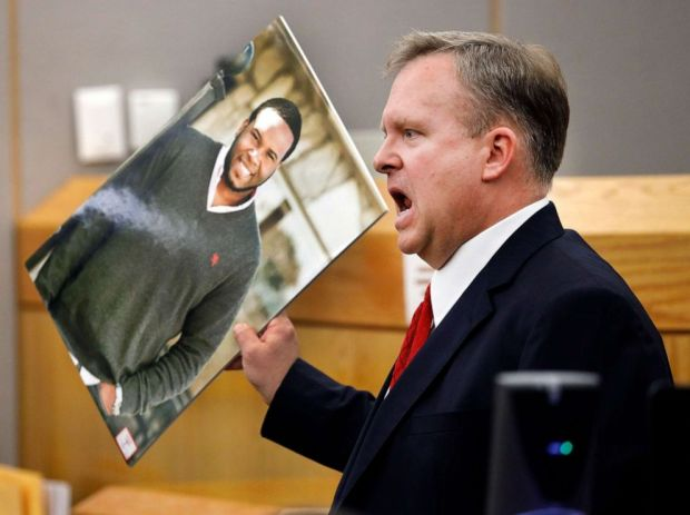 PHOTO: Assistant District Attorney Jason Hermus waves a photo of Botham Jean at the jury as he presents his closing arguments in Amber Guygers murder trial in Dallas, Texas, Sept. 30, 2019.