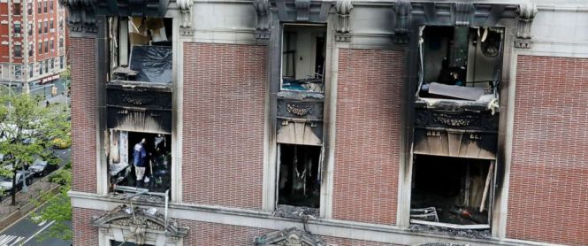 Photo Fire Marshals Sift Through A Burned Out Apartment In New Yorks Harlem Neighborhood