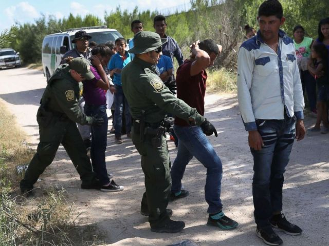 PHOTO: Border Patrol agents take a group of Central American asylum seekers into custody on June 12, 2018, near McAllen, Texas.