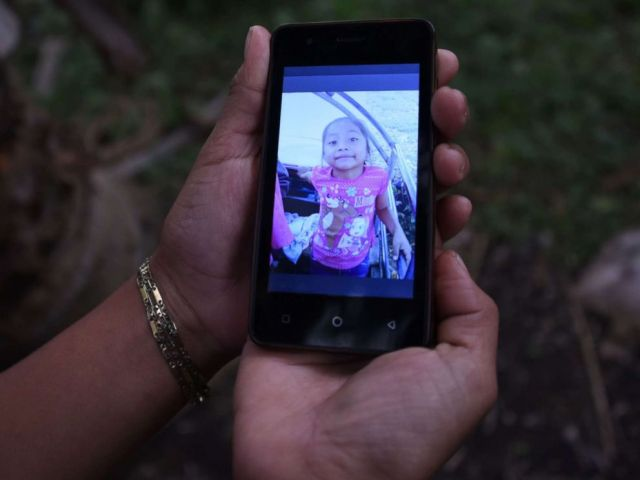 PHOTO: A relative shows a picture of 7-year old Jakelin Caal Maquin, who died in a Texas hospital two days after being taken into custody by border patrol agents, north of Guatemala city, Dec. 15, 2018.