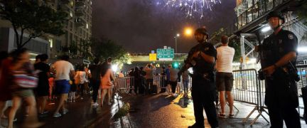 PHOTO: In this file photo from July 4, 2016, counterterrorism police officers watch over spectators for the Fourth of July fireworks along the East River in New York.