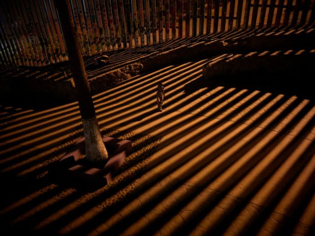 PHOTO: In this Jan. 11, 2019 photo, a boy plays as floodlights from the United States filter through the border wall in Tijuana, Mexico.