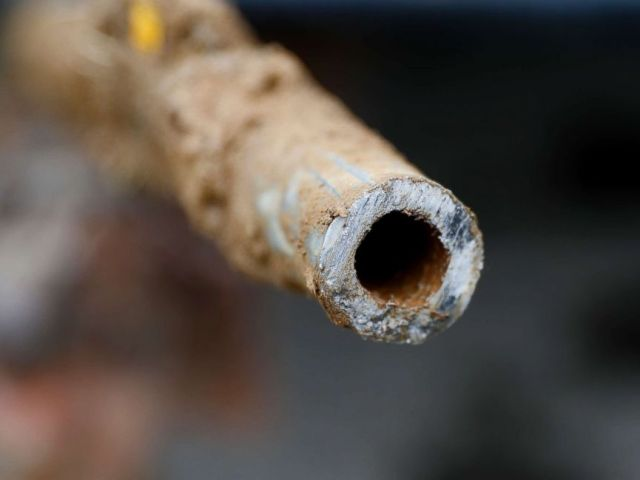 PHOTO: A lead pipe is shown after being replaced by a copper water supply line to a home in Flint, Mich., July 20, 2018.