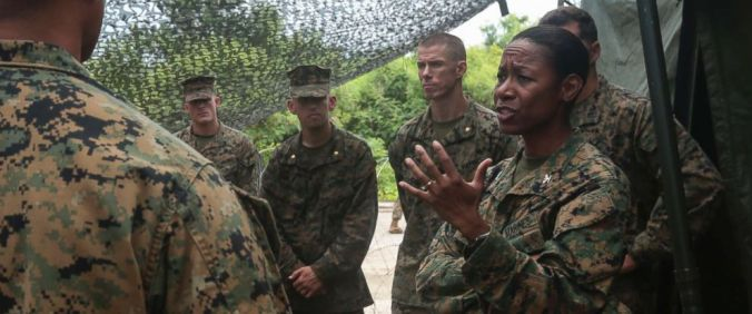 PHOTO: U.S. Marines listen to Colonel Lorna Mahlock on a visit to the Northern Mariana Islands, Sept. 14, 2016.