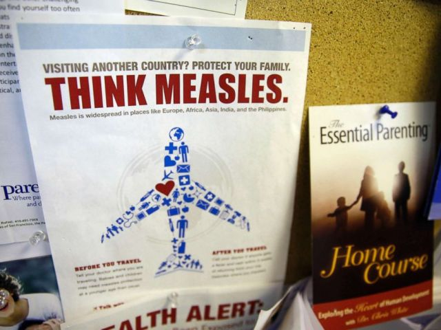 PHOTO: A flyer educating parents about measles is displayed on a bulletin board at a pediatrics clinic in Greenbrae, Calif., Feb. 6, 2015.