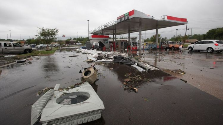 A gas station is damaged following severe weather, Saturday, April 13, 2019 in Vicksburg, Miss. Authorities say a possible tornado has touched down in western Mississippi, causing damage to several businesses and vehicles.