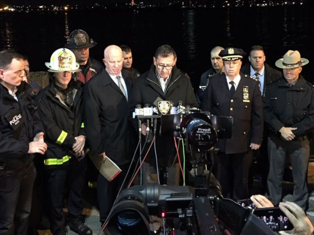 PHOTO: FDNY Commissioner Daniel Nigro, center, and NYPD Commissioner James ONeill, to his right, hold a news conference after a helicopter crashed in the East River in Manhattan on March 11, 2018.