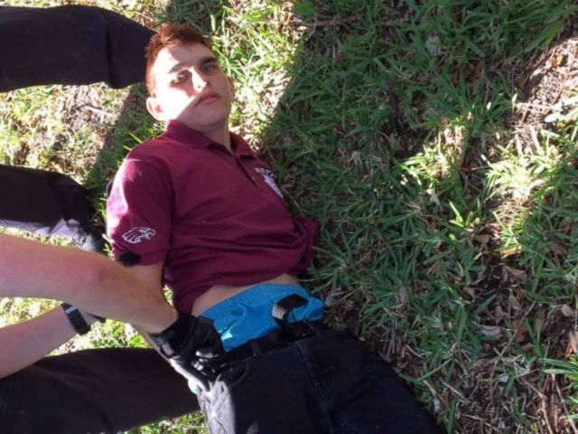 PHOTO: Nikolas Cruz is placed into handcuffs by police near Marjory Stoneman Douglas High School following a mass shooting in Parkland, Fla., Feb. 14, 2018.