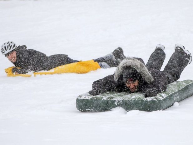PHOTO: People sled on the Boston Common as Winter Storm Skylar bears down, March 13, 2018, in Boston.
