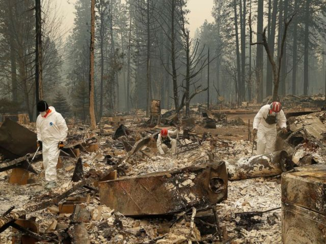 PHOTO: Search and rescue workers search for human remains at a trailer park burned by the Camp Fire, Nov. 13, 2018, in Paradise, Calif.
