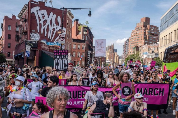 PHOTO: People with and without masks participate in a pride parade in New York, June 27, 2021.