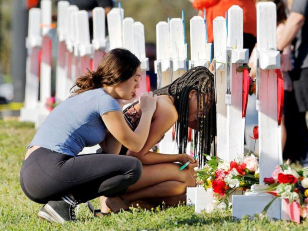 PHOTO: A senior at Marjory Stoneman Douglas High School weeps in front of a cross and Star of David for shooting victim Meadow Pollack while a fellow classmate consoles her at a memorial by the school in Parkland, Fla., Feb. 18, 2018.