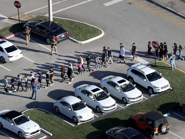 PHOTO: People are brought out of the Marjory Stoneman Douglas High School after a shooting at the school that reportedly killed and injured multiple people on Feb. 14, 2018 in Parkland, Fla.