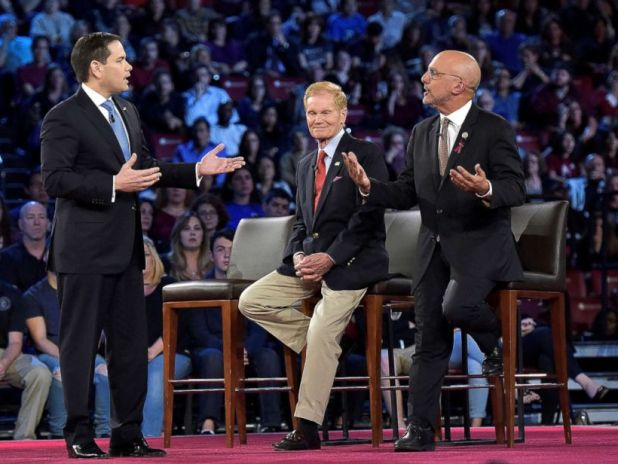 PHOTO: Senator Marco Rubio, left, and Congressman Ted Deutch disagree during a CNN town hall meeting at the BB&T Center, in Sunrise, Florida, Feb. 21, 2018.