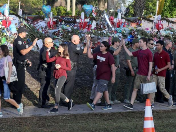 PHOTO: Students are greeted by law enforcement officers as they head back to school at Marjory Stoneman Douglas High School, Feb. 28, 2018 in Parkland, Fla.