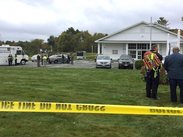 PHOTO: In this photo provided by WMUR-TV, police stand outside the New England Pentecostal Church after reports of a shooting on Oct. 12, 2019, in Pelham, N.H.