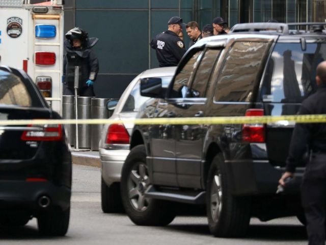 PHOTO: A member of the New York Police Department bomb squad is pictured outside the Time Warner Center in New York City after a suspicious package was found inside the CNN Headquarters.