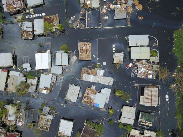 PHOTO: An aerial view of the flooded neighborhood of Juana Matos in the aftermath of Hurricane Maria in Catano, Puerto Rico, Sept. 22, 2017.