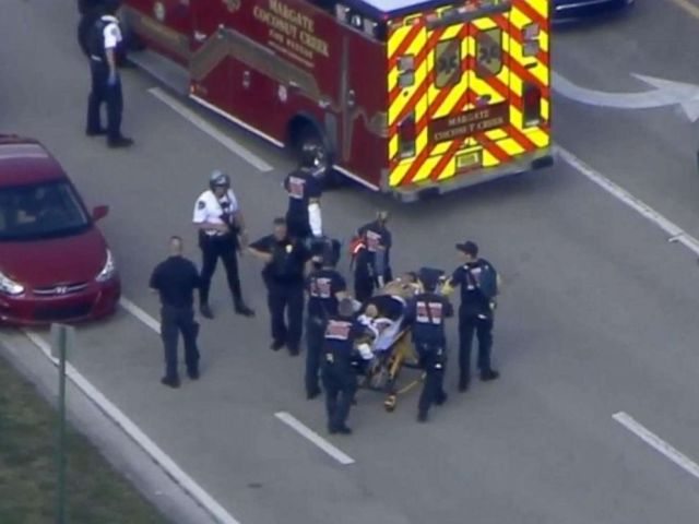PHOTO: First responders transport a person on a stretcher after reports of a shooting at Stoneman Douglas High School in Parkland, Fla., Feb. 14, 2018.