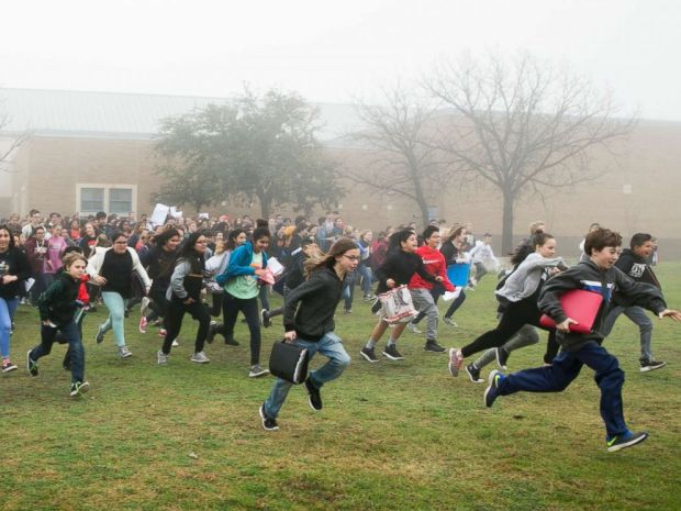 PHOTO: Bailey Middle School students run to the front of the school to begin a gun control protest on in Austin, Texas, on Feb. 23, 2018.