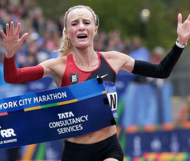 Shalane Flanagan Of The United States Crosses The Finish Line First In The Womens Division Of
