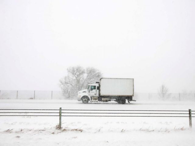 PHOTO: A truck drives north on I-25 during the snowstorm in Colorado Springs, Colo., March 13, 2019.