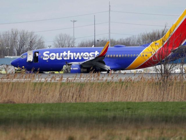 PHOTO: A Southwest Airlines plane sits on the runway at the Philadelphia International Airport after it made an emergency landing in Philadelphia, April 17, 2018.