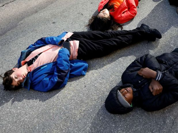PHOTO: Students from Fiorello H. Laguardia High School lie down on West 62nd street in support of the National School Walkout in the Manhattan borough of New York, March 14, 2018.