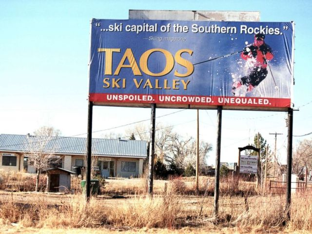 PHOTO: A billboard for Taos Ski Valley in New Mexico stands above barren ground, Feb. 9, 2000.