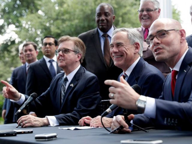 PHOTO: Texas Gov. Greg Abbott, Lt. Governor Dan Patrick, and Speaker of the House Dennis Bonnen, seated right, and other law makers attend a joint press conference to discuss teacher pay and school finance.
