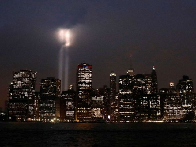 PHOTO: The Tribute in Light installation is illuminated over lower Manhattan as seen from Brooklyn, September 11, 2018.
