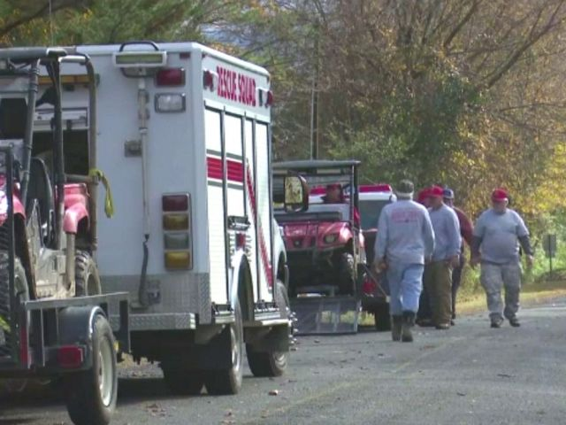 PHOTO: First responders assist on a scene where a 21-year-old college student was found dead after a rappelling accident at the Valhalla Cave in Jackson County, Alabama.