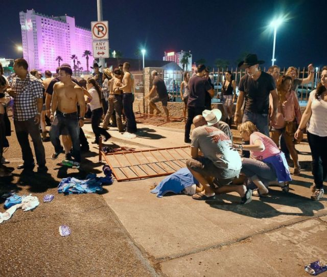 Photo People Tend To The Wounded Outside The Festival Grounds Oct