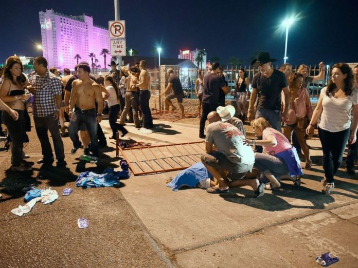 PHOTO: People tend to the wounded outside the festival grounds, Oct. 1, 2017, in Las Vegas.