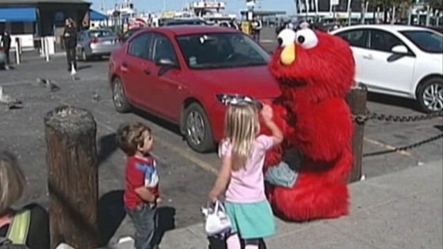 evil elmo moves to