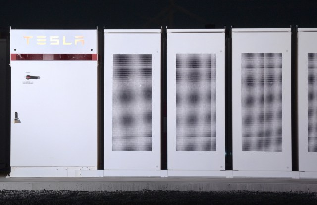 TeslaInc. Powerpacks that will be used to form theworld's largestlithium-ionbattery stand on display at the Hornsdale wind farm, operated by Neoen SAS, near Jamestown, South Australia, on Friday, Sept. 29, 2017.Against a backdrop of wind turbines 150 miles (241 kilometers) north of Adelaide, Tesla Chief Executive Officer Elon Musk announced a contract to build theworld's largestlithium-ion battery system had been signed with South Australia's power distributor, triggering a 100-day self-imposed deadline to install the electricity storage system. Photographer: Carla Gottgens/Bloomberg via Getty Images