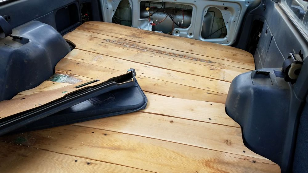medium resolution of inside a sturdy wooden floor covers the rear seat and cargo area just the thing for lots of bicycle parts or camping gear