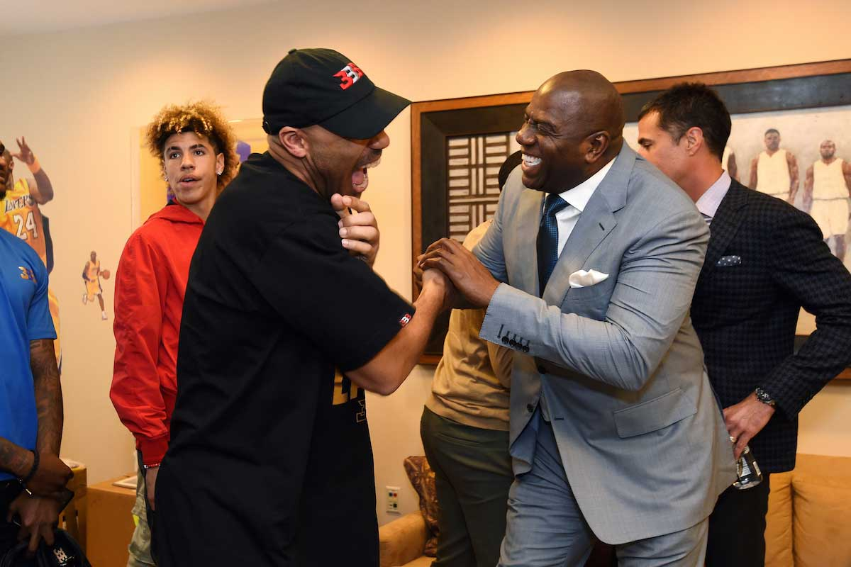 LaVar Ball shakes hands with President of Basketball Operation of the Los Angeles Lakers Magic Johnson following a press conference to introduce Los Angeles Lakers 2017 NBA Draft picks