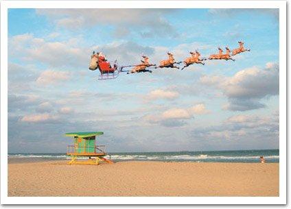 Santa And Sleigh Over Beach Christmas Card