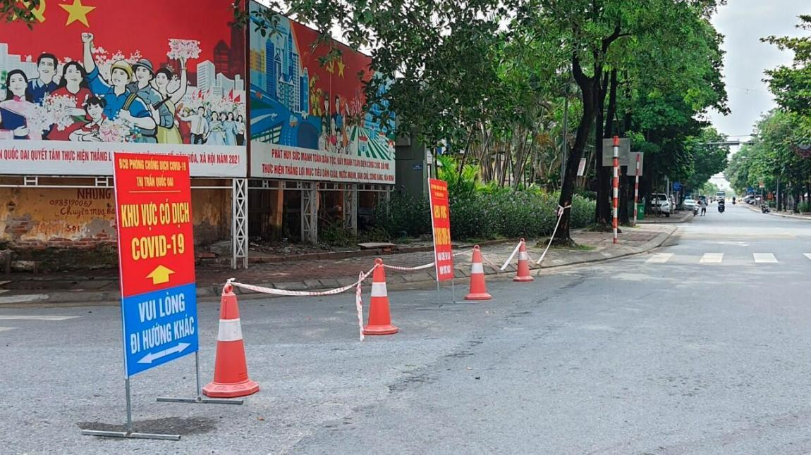 A road is cordoned off to control traffic in Hanoi, Vietnam, on Saturday, July 24, 2021.