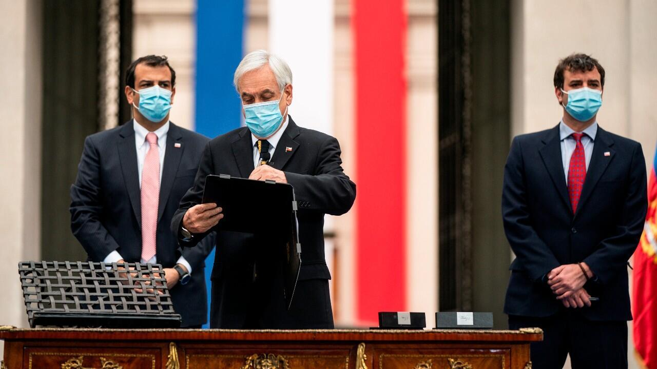 The president of Chile, Sebastían Piñera signs the decree that calls the first session of the Constitutional Convention in charge of drafting and proposing a new Constitution.  At the Palacio de la Moneda, in Santiago de Chile, on June 20, 2021.
