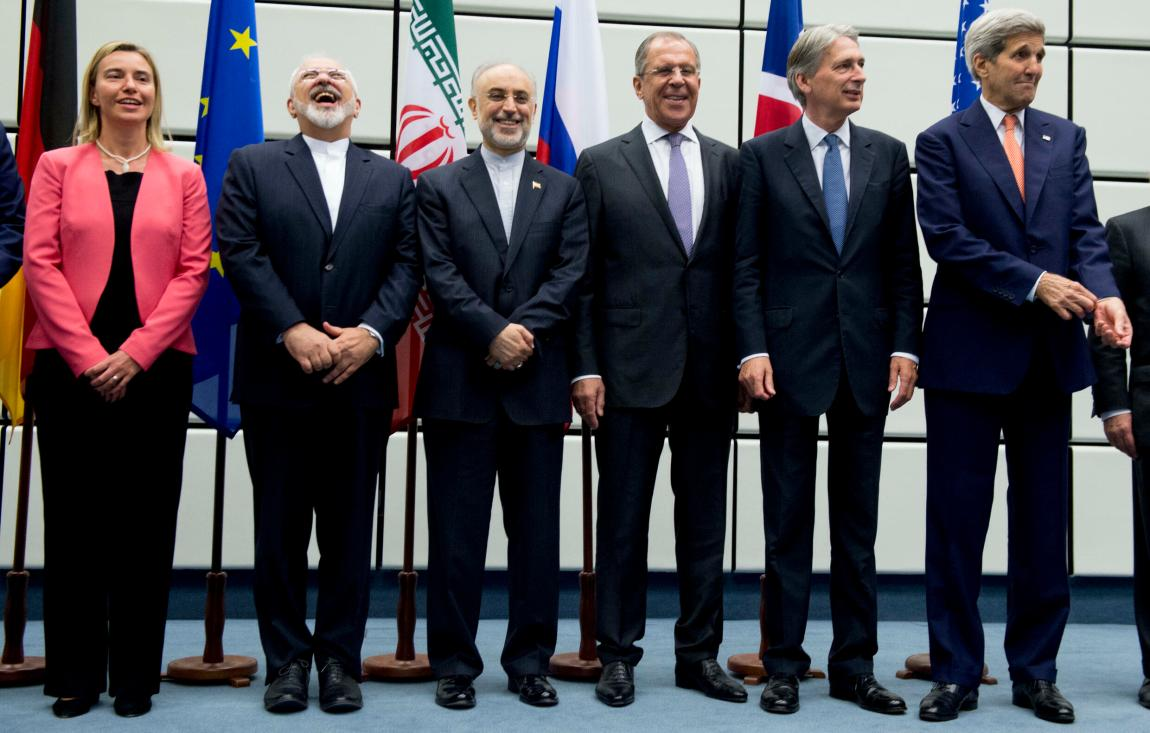 In this July 14, 2015 file photo, from left: European Union High Representative Federica Mogherini, Iranian Foreign Minister Mohammad Javad Zarif, Head of Iran's Atomic Energy Organization , Ali Akbar Salehi, the Minister of Foreign Affairs of Russia, Sergey Lavrov, the Secretary of Foreign Affairs of Great Britain.  Philip Hammond and US Secretary of State John Kerry pose for a group photo after world powers and Iran reached a historic agreement.