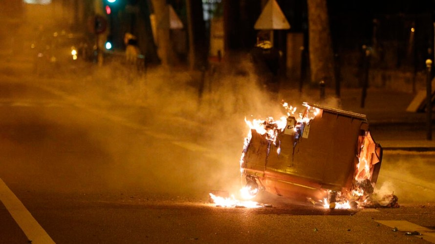 A rubbish bin burns in the street during clashes in Villeneuve-la-Garenne, in the northern suburbs of Paris, early on April 21, 2020.