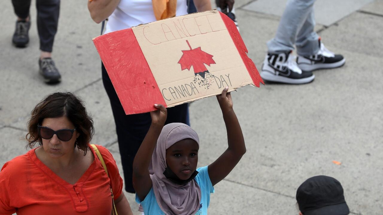 Canadians marched in Toronto in memory of the hundreds of indigenous children found dead in former Catholic schools on July 1, 2021, Canada Day.