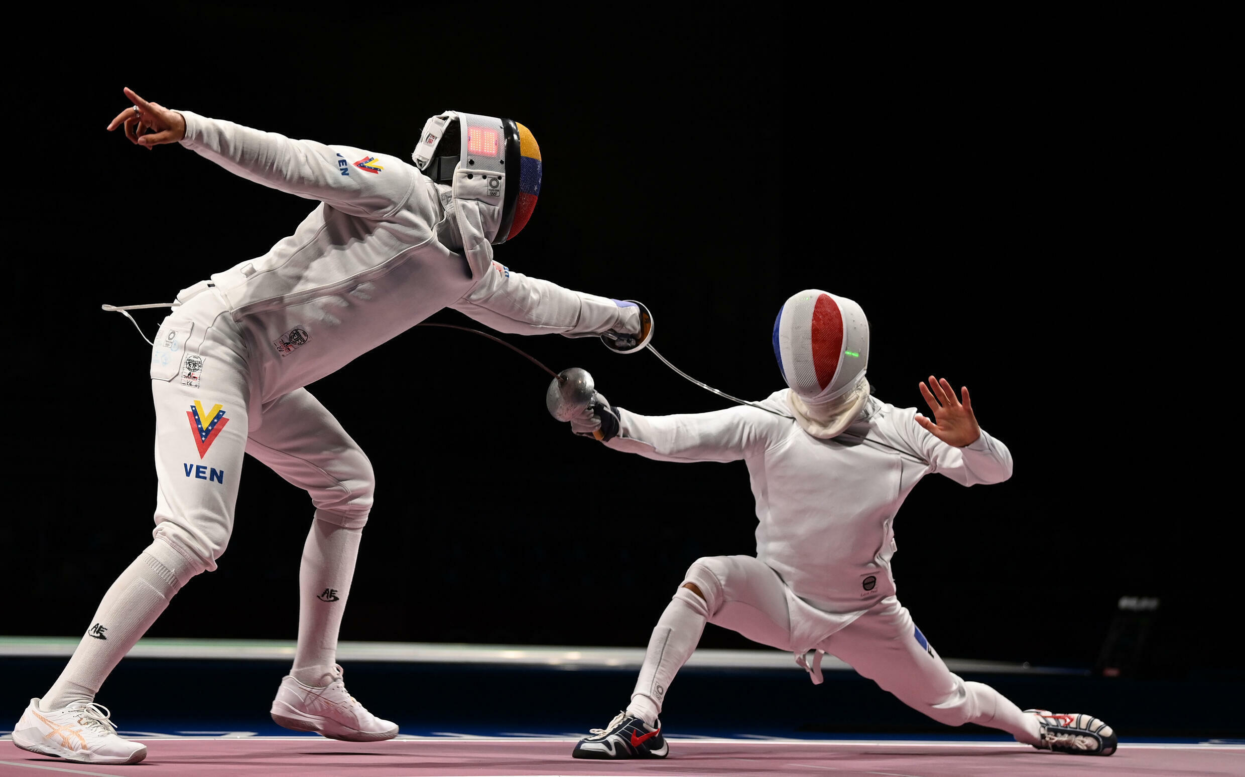 Venezuelan Rubén Limardo Gascon competes against France's Romain Cannone in the men's individual sword qualification fight, during the Tokyo 2020 Games, at the Makuhari Messe Hall in Chiba city, Chiba prefecture, Japan, on July 25, 2021.