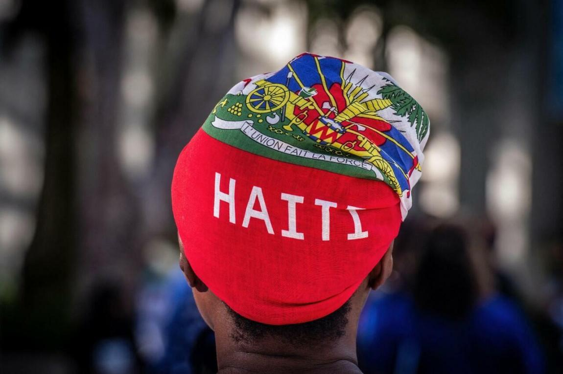 A woman attends a vigil for Haitian First Lady Martine Moïse outside Jackson Memorial Hospital in Miami, the United States, on July 16, 2021.