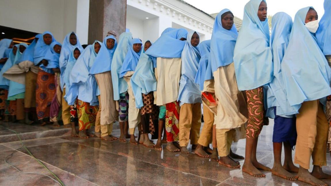 File - Dozens of girls who were abducted from a boarding school line up after being released in northwestern Nigeria's Zamfara state on March 2, 2021.