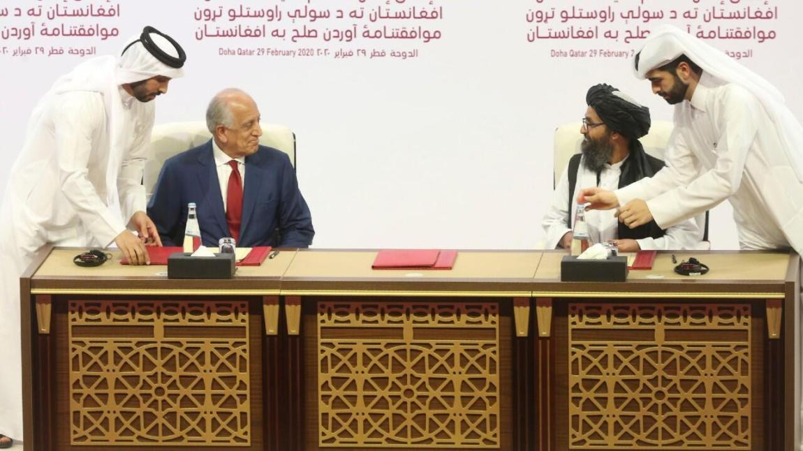 US peace envoy Zalmay Khalilzad, left, and Mullah Abdul Ghani Baradar, the Taliban group's top political leader, sign a peace agreement between the Taliban and US officials in Doha, Qatar, on February 29, 2020.